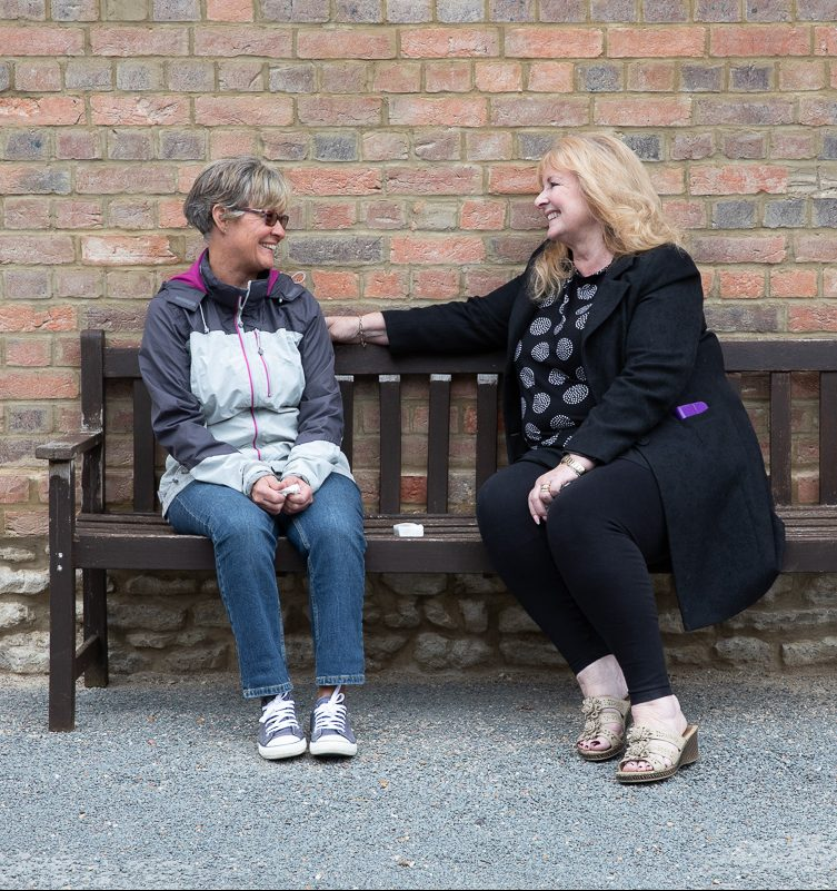 Casework counselling a victim on park bench